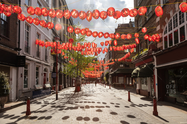 London, United Kingdom - May 1, 2020: View of empty street in Chinatown decorated with red lanterns during the Corona virus crisis