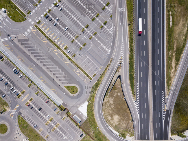 Aerial view of empty car park next to a motorway in Florence, Italy during the Corona virus crisis.
