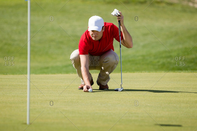 Male golfer focused on his putting