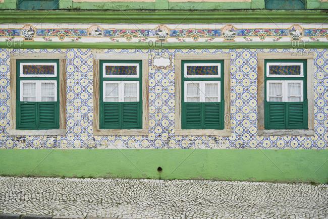 Moorish tiles decorate the facade of a house block in Alcochete, Portugal