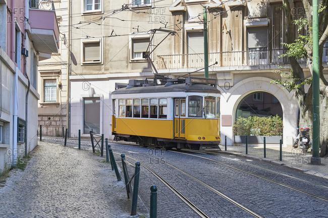 Tramway on cobblestone street in the Lapa neighborhood, Lisbon, Portugal