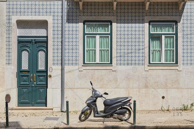 Home exterior with blue tile around window and door Lapa neighborhood, Lisbon, Portugal