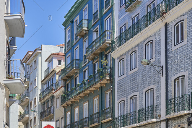 Low angle view of multicolored apartments in the Lapa neighborhood in Lisbon