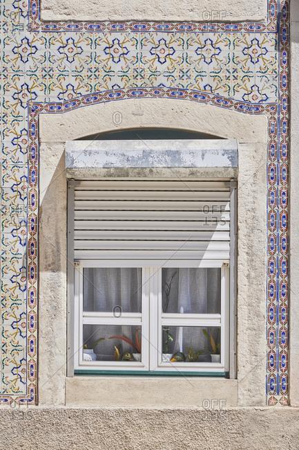 Home exterior with tile around window, Lapa neighborhood, Lisbon, Portugal