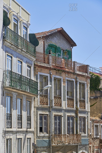 Multicolored tiled facades of apartments in the Lapa neighborhood in Lisbon
