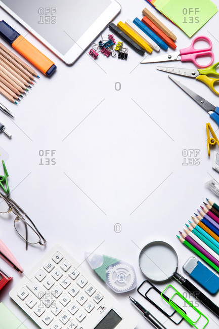 Office supplies arranged on a white desk
