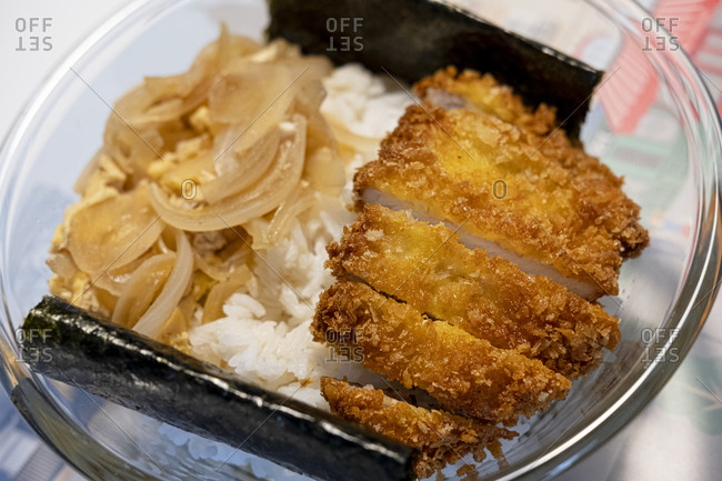 Katsudon with onion, egg, algae and rice