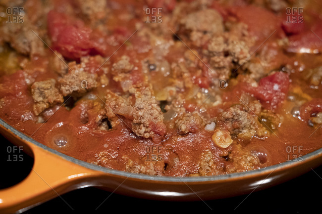 Minced meat with garlic, onion and tomato in a pan
