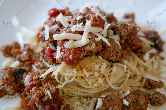 Spaghetti Bolognese dish topped with cheese
