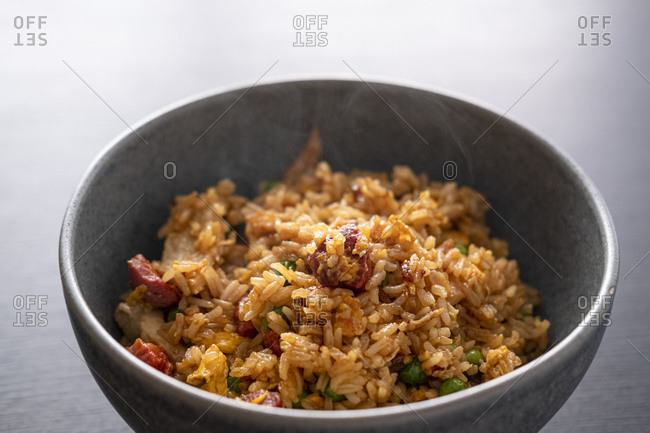 Fried rice with turkey and chorizo served in a bowl