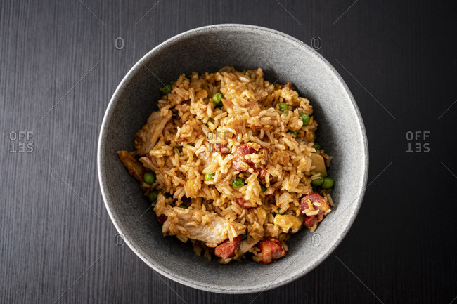 Overhead view of a bowl of fried rice with turkey and chorizo