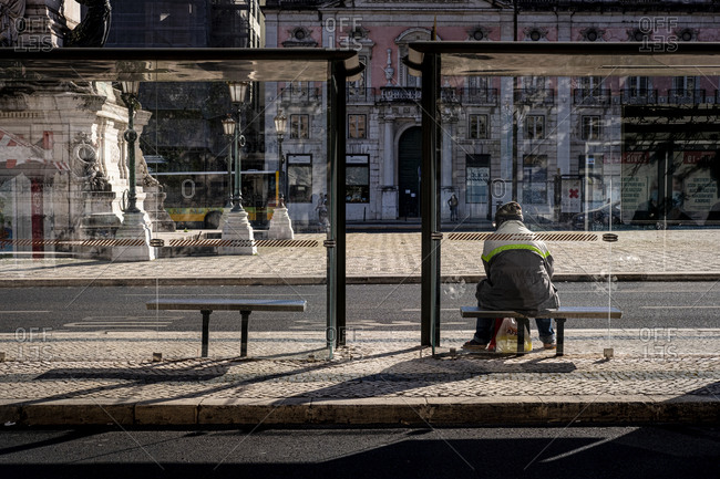 Lisbon, Portugal - May 23, 2020 : Man waiting for the bus in Restauradores Square