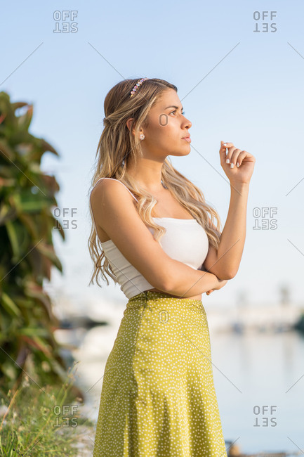 Thoughtful young woman at the marina