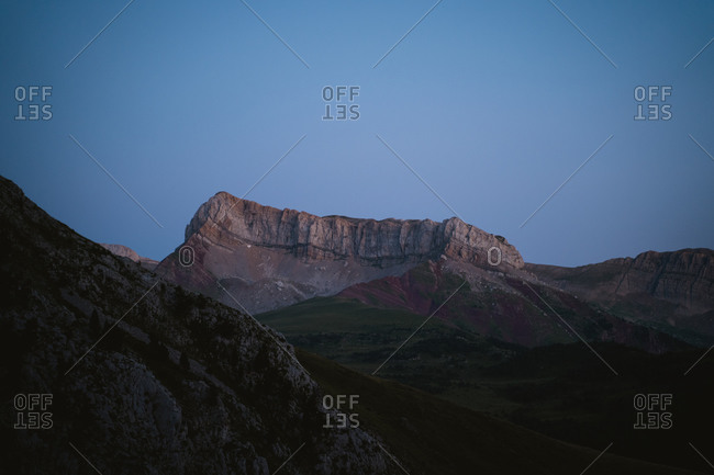 Rugged mountain range under nighttime sky in the Pyrenees Mountains
