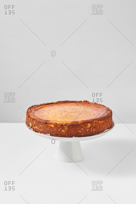 Freshly baked cheesecakes from delicious sweet cottage cheese on a plate on a light gray background with soft shadows, copy space.