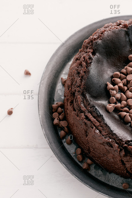 Overhead view of a chocolate basque burnt cheesecake with chocolate chips