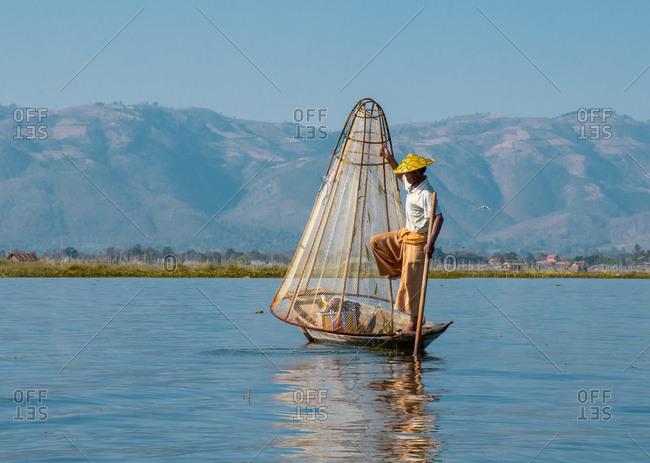 Inle, Yangon Region, Myanmar - January 16, 2020: Unique way to fish in Myanmar