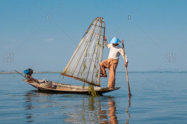 Inle, Yangon Region, Myanmar - January 16, 2020: Local man fishing at Inle Lake