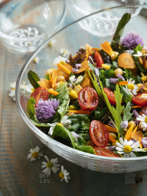 Bowl with a healthy mixed summer salad