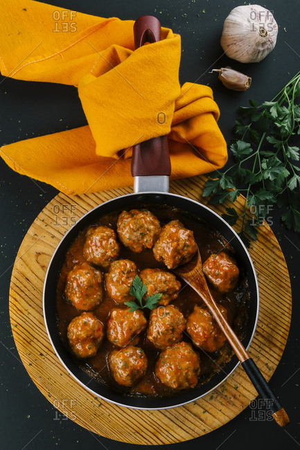 Pan with hot homemade meatball stew seasoned with spices for flavor