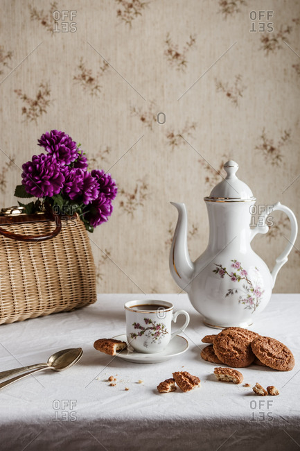 Coffee served on classic tableware with cookies in a vintage home