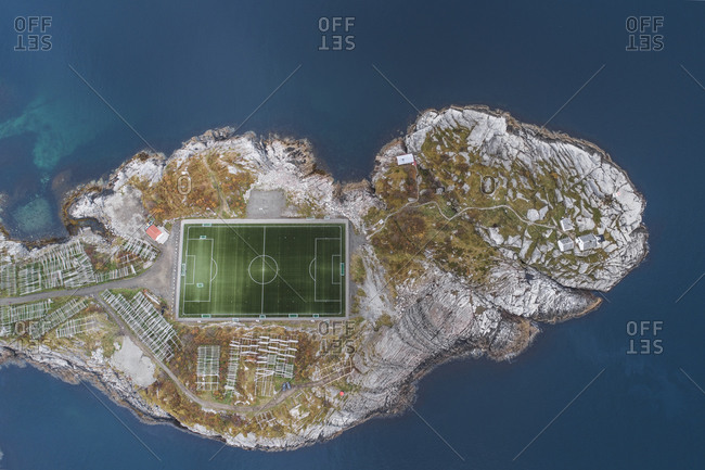 Soccer field on the cliffs of Henningsvaer by the sea