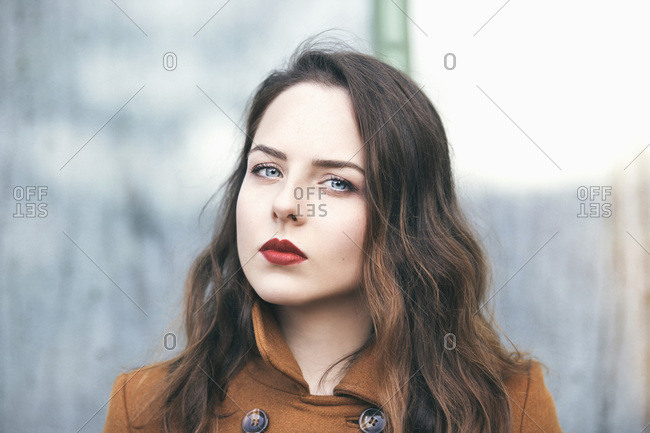 Portrait of a young beautiful woman with bright blue eyes