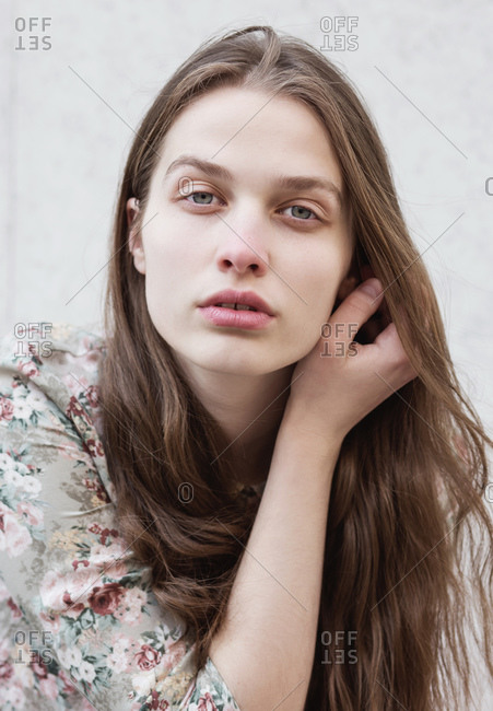 Portrait of young beautiful woman without makeup