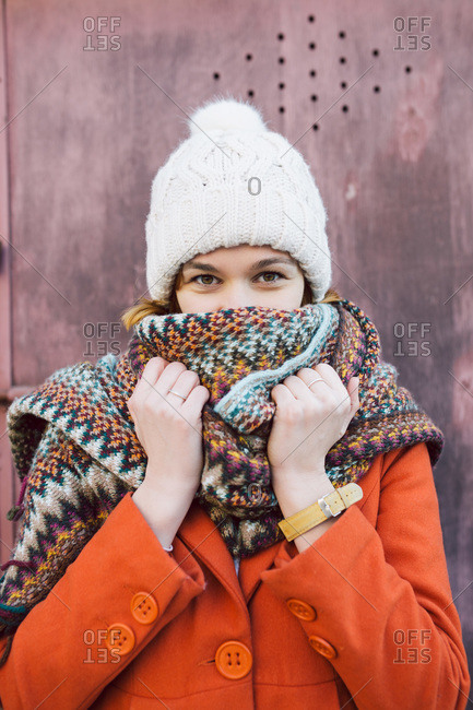 Portrait of young woman with winter hat and scarf