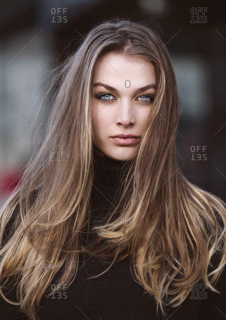 Fashion portrait of a beautiful woman with bright blue eyes