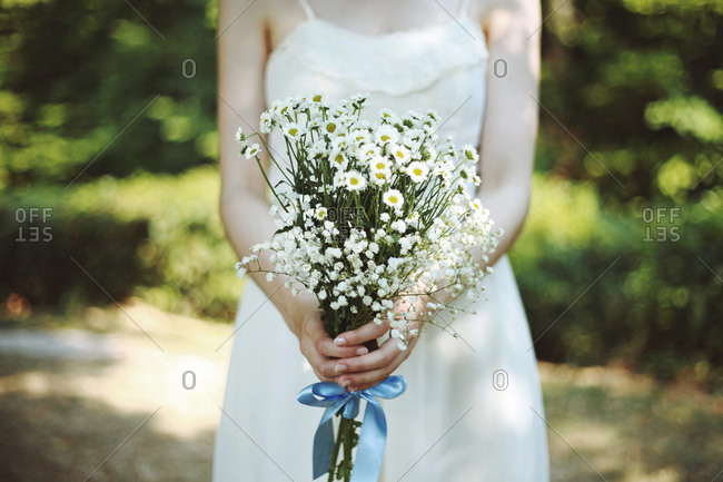 Woman holding a flowers bouquet