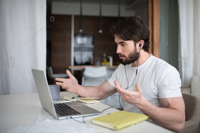 Bearded man speaking with client online