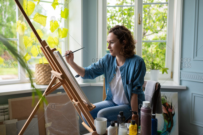 Artist creating artwork in home studio