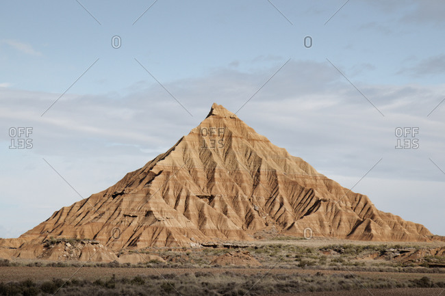 Imposing mountain of sand in the middle of the desert