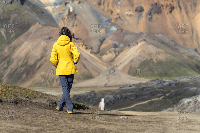 Young woman is admiring Iceland's foreign volcanic landscape