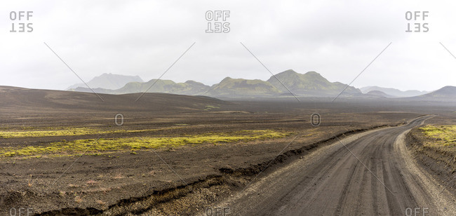 Gravel road in Iceland's highlands leading to adventure