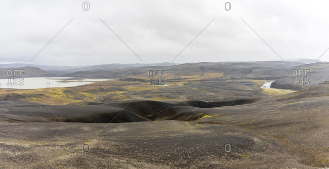 Black lava rock highlands in Iceland with rivers flowing through