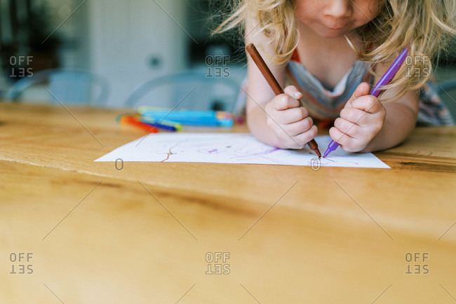 Little toddler girl drawing at home