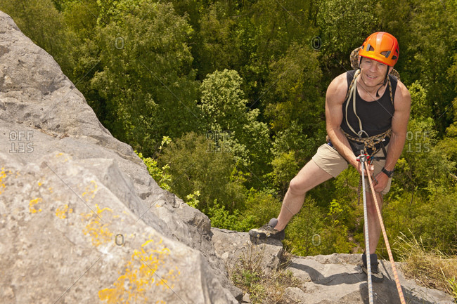 Man rappelling of cliff in south Wales