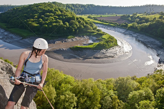 Woman rappelling of cliff in south Wales