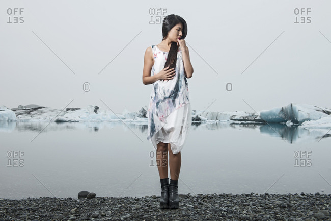 Beautiful woman posing for fashion photoshoot at glacier lagoon