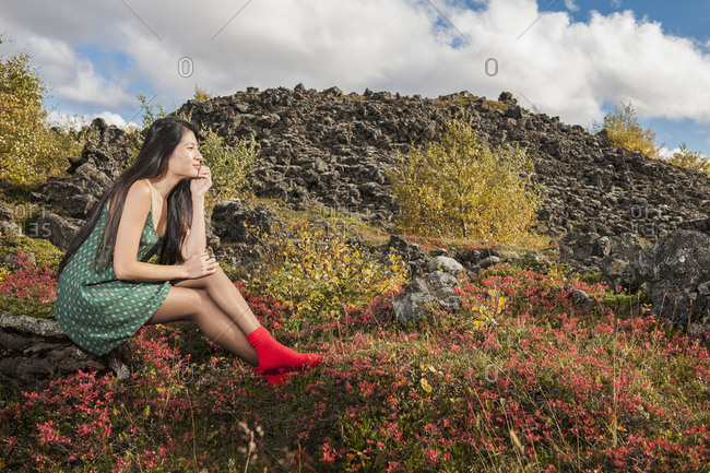Beautiful woman relaxing at Icelandic meadow