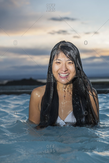Woman enjoying geothermal spa in north Iceland