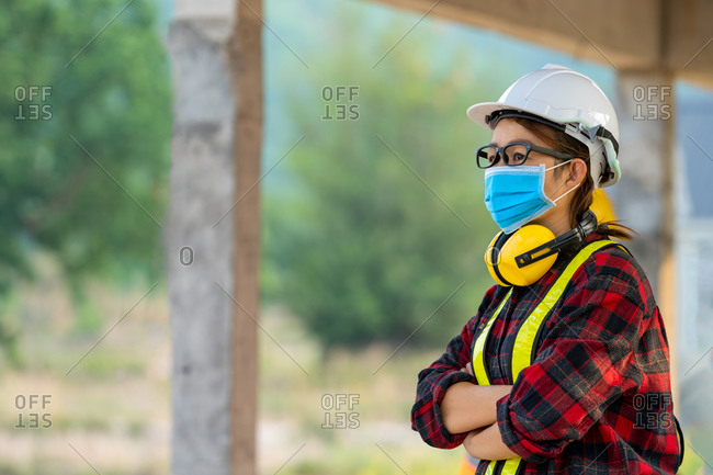 Female engineer wearing protective mask to protect against Covid