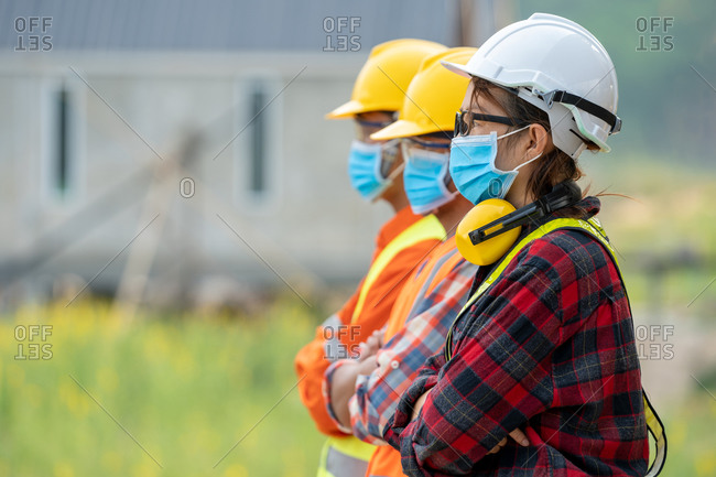 Group of Asian engineers wearing protective mask to protect against Covid