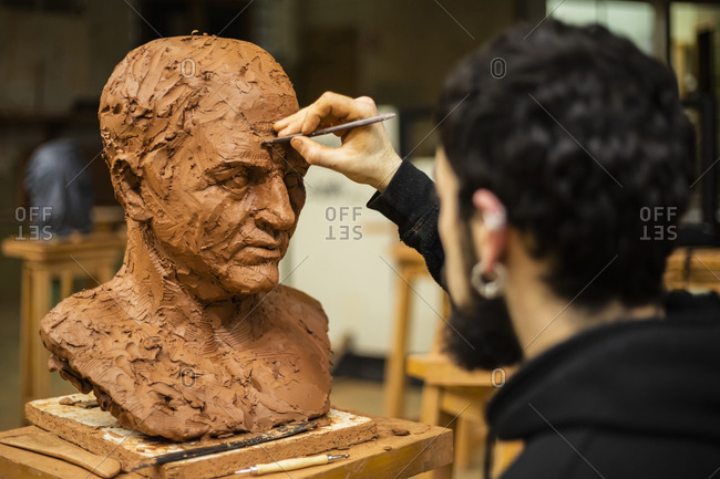 Sculptor finishing a clay head