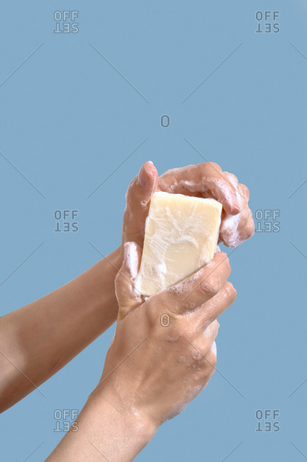 Woman wash hands with homemade soap