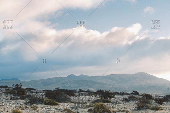 Clouds over volcanic desert landscape