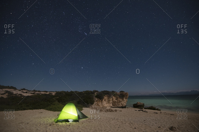 A tent at night in a beach at Del Carmen Island in Loreto
