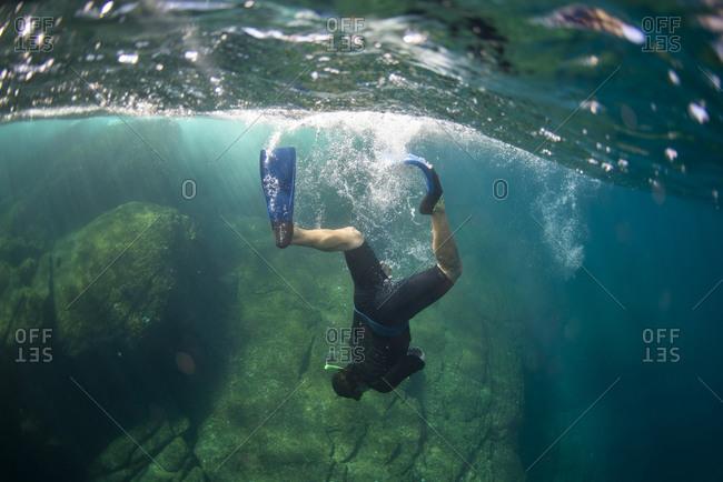 One man diving near Coronado Island in Loreto, Baja California, Mexico.